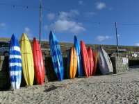 Surf boards waiting for their surfers