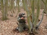 Have a go of playing paintball.