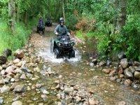 quad biking trough the river
