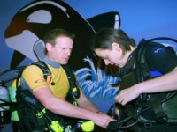 Getting fitted with help from the instructor