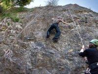 Climber and partner belaying