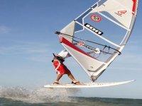A windsurfer jumping