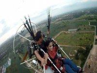 Couple enjoying a paramotor ride