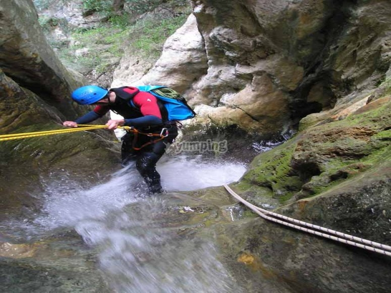 Abseiling down a waterfall