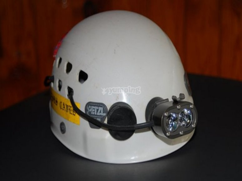 Caving helmet and lamp
