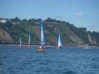 Sailboat dotted shoreline
