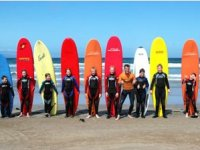 A Pose with Their Surfboards