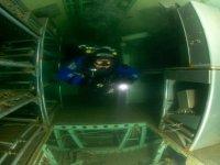 Diver swims thru aircraft