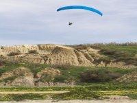 Flying along sand dunes