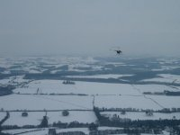 Flying over snowy landscape