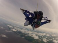 Tandem jump over the clouds