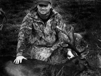 Hunter with Fallow Buck
