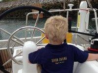 Boy enjoying the sailing experience