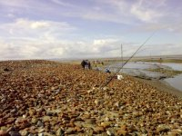 Fishing on Caldy Beach
