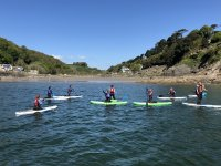 A great day on the water with a group of hens enjoying paddle boarding salcombe