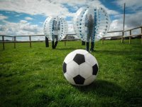 Play a game of body zorb football.