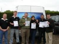 Proud divers and their PADI certificates