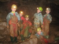 Minors wearing miner's helmets