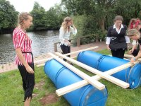 Girls building the raft