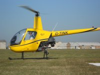 R22 solo hovering at Cambridge Airport