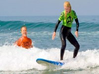 Surfing coach and pupil