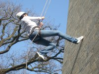 Abseiling down a building