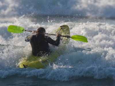 Surfk kayaking along the coast for beginners
