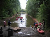 Kayaks and canoes on the river together