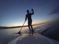 Stand up paddelboarding and sunset