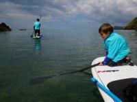 Child doing paddle boarding