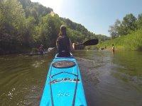kayaking through the river