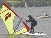 Windsurfing combines sailing and surfing