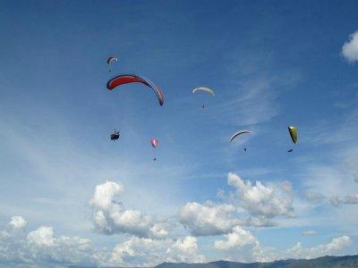 Paragliding flight in As Catedrais beach