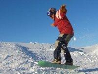 Snowboard with Harwood Ski Federation.