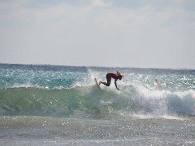 Surfing board and neoprene/lycra renting