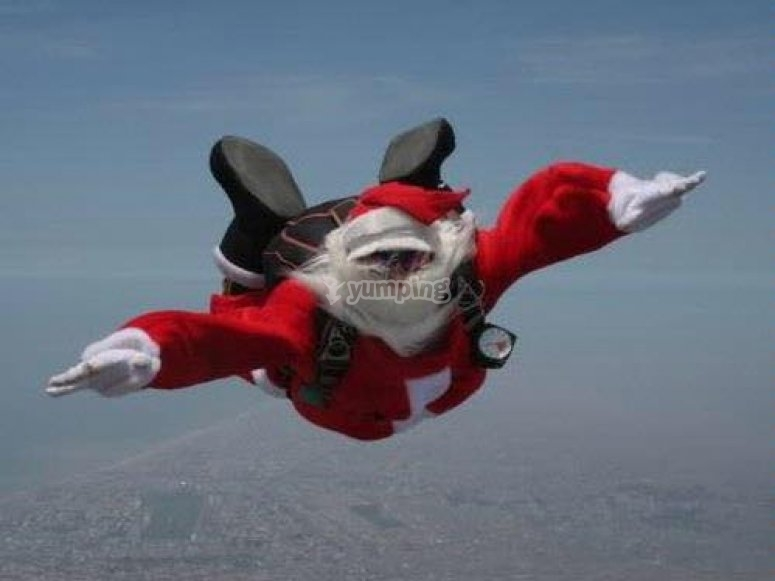 Santa Claus changes his sleigh for skydiving.jpg