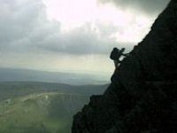 abseiling on cliff