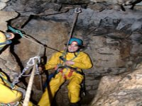 Abseiling into the cave system
