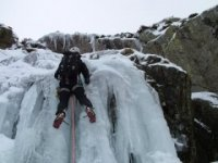 Ice climber challenged by the frozen waterfall