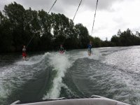 Wakeboarding in a group of three people