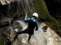 Climbing down a waterfall