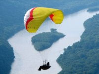 Paragliding over a river