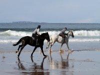 Riding on a beach