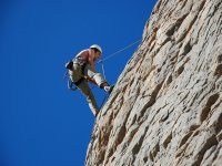 Abseiling down a rocky mountain