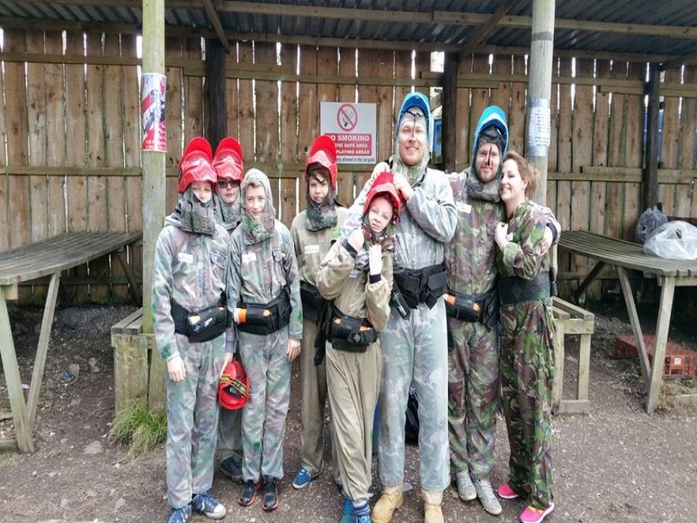 The group is ready to play paintball