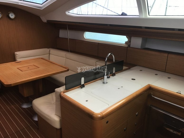 Jeanneau Sun Odyssey 45 kitchen and dinner area.