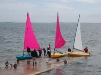 Launching the sailing boats into the water