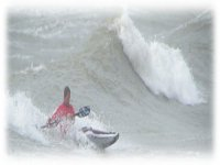 Learn how to do kayak surfing.