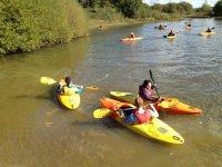 Group kayaking session on the lake