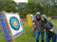 practice archery with friends at West Lakes Adventure